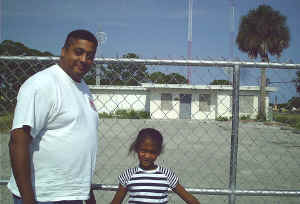 WWKO 860 AM Cocoa Chris Hill & daughter.jpg (740520 bytes)